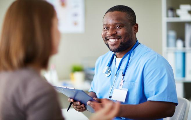 Male African American Nurse Talking Patient