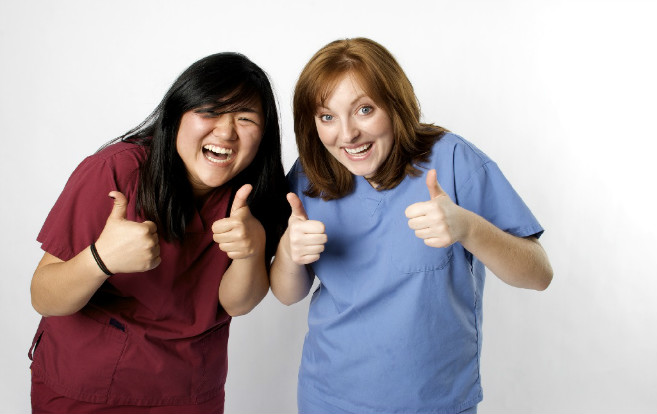asian_nurse_white_nurse_excited_giving_thumbs_up