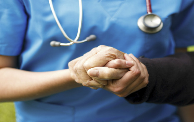 holding_hands_closeup_female_nurse_elderly_patient
