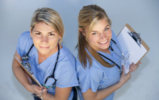 two_nurses_from_above_smiling_clipboards